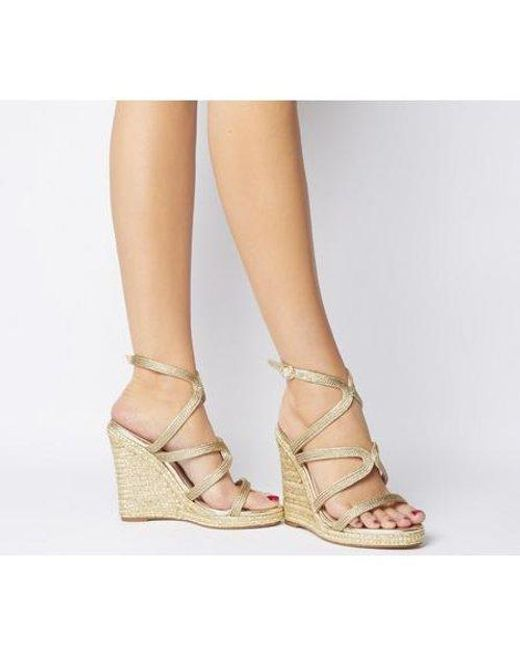 Gold metallic strappy high heel wedge sandals
