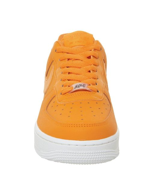 buy popular c2e78 ef098 ... Nike - Orange Air Force 1 07 Trainers - Lyst ...