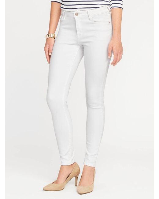 bfab2cbd923 Lyst - Old Navy Mid-rise Rockstar Super Skinny Jeans in White
