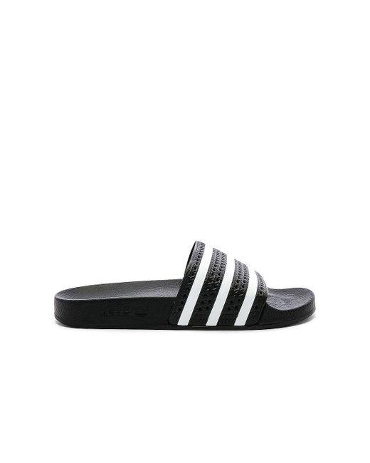 Adidas Originals Adilette サンダル. Size M 10 / W 11, M 12 / W 13, M 11 / W 12. Black
