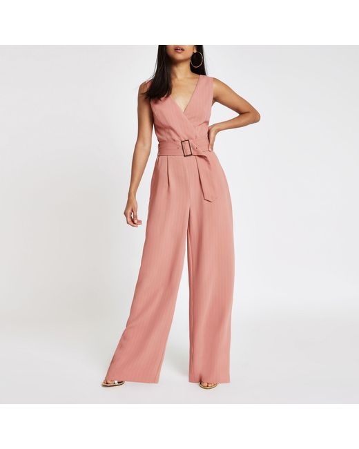 acfbb4427124 Lyst - River Island Petite Pink Belted Wide Leg Jumpsuit in Pink