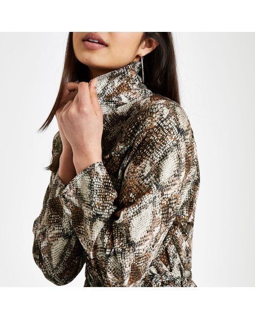 9a0c840a7ea ... River Island - Brown Snake Print Jumpsuit - Lyst