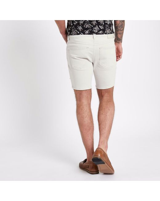 Mens Cream slim fit ripped denim shorts River Island qqxILd9s