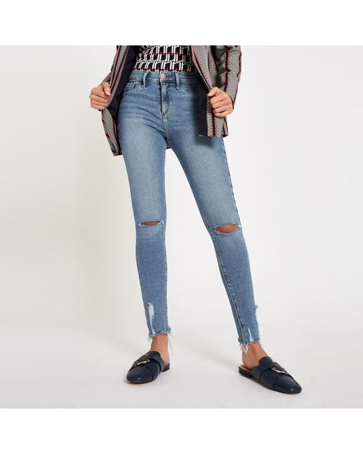 bb8809fd6ee317 Lyst - River Island Light Blue Molly Ripped Knee jeggings in Blue