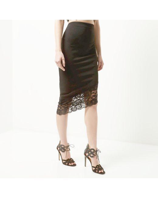 river island black asymmetric lace hem pencil skirt in