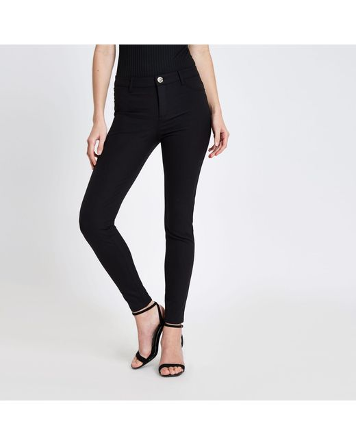 c85dbf12ea68 River Island Molly Skinny Fit Pants in Black - Save 58% - Lyst