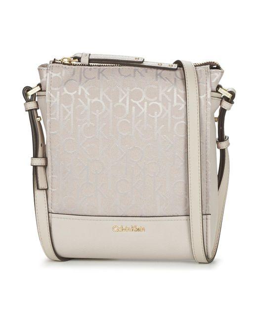 Calvin Klein - Natural Marina Logo Flat Crossbody Shoulder Bag - Lyst
