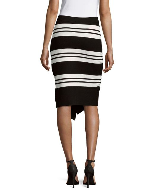 leo wrap front pencil skirt in black lyst