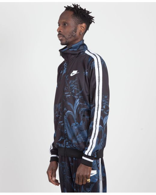a99cd9094aaa ... Nike - Blue Black dark Obsidian white Floral Nsw Tape Track Jacket for  Men ...