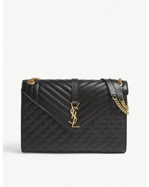 0e5bbfa124 Saint Laurent - Black And Gold Modern Monogram Quilted Pebbled Leather  Satchel - Lyst