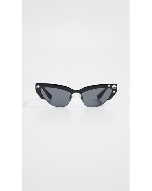 c2c9f76ffd Miu Miu - Multicolor Narrow Cat Eye Sunglasses - Lyst ...
