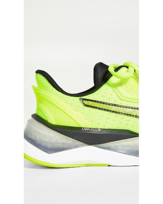 Women's Yellow Lqd Cell Shatter Xt Shift Sneakers