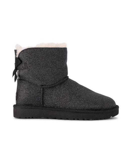 80b8ec7b5ea UGG Mini Bailey Bow Black Sheepskin And Glitter Ankle Boots. Women's ...