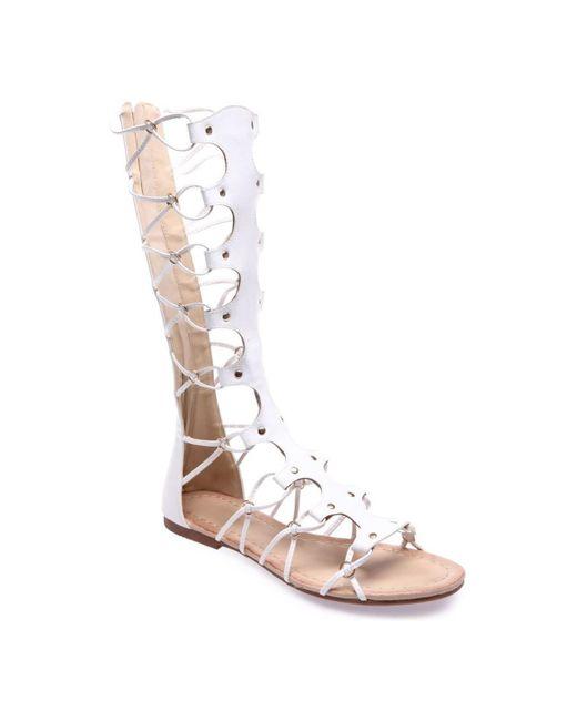 Spartiates blanches montantes brides croisées Sandales La Modeuse en coloris White