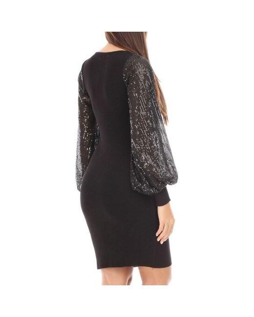 Robe pull noire à manches bouffantes et sequins Robe La Modeuse en coloris Black