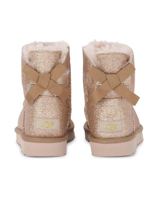 f16a5ccb3fb UGG Mini Bailey Bow Sheepskin And Golden Glitter Ankle Boots Women's ...