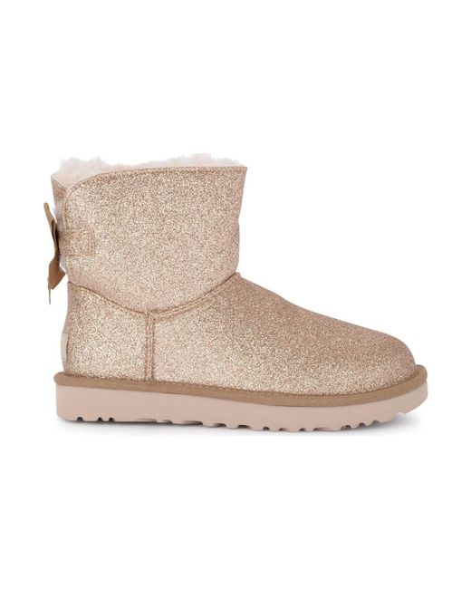 243fde73ded Metallic Mini Bailey Bow Sheepskin And Golden Glitter Ankle Boots Women's  Snow Boots In Gold