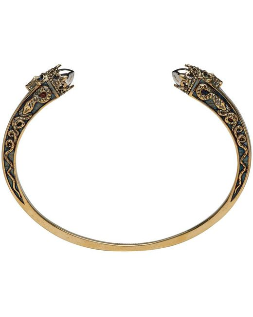 Alexander McQueen   Metallic Gold Twin Skull Engraved Bracelet for Men   Lyst