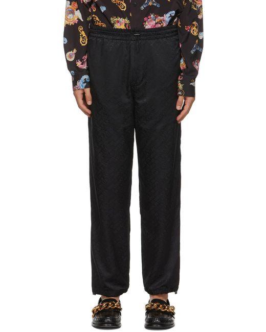 メンズ Versace Jeans ブラック ロゴ スウェットパンツ Black