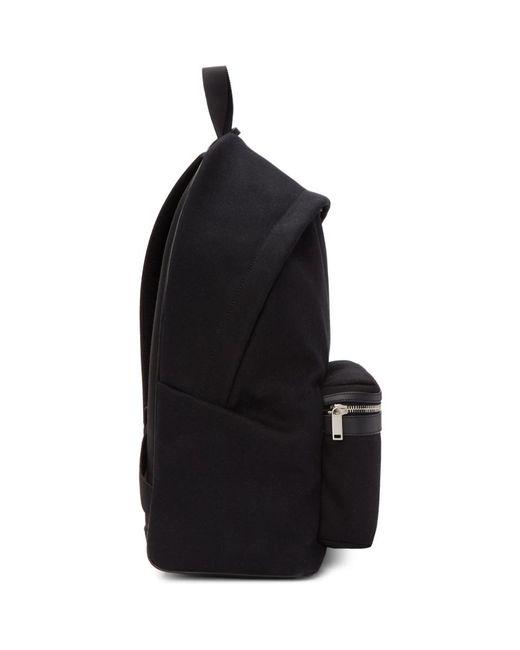 6bca352de ... Saint Laurent - Black Canvas Embroidered City Backpack for Men - Lyst  ...