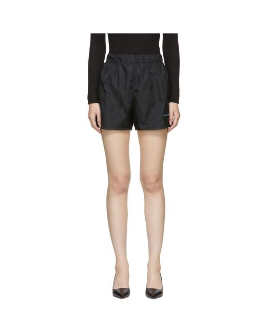 Short en nylon a ecusson noir Sport Prada en coloris Black