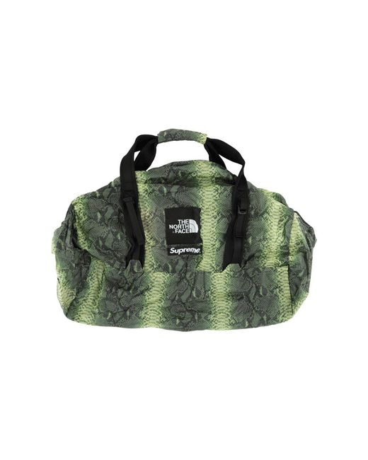 abce62a4b7e8 Lyst - Supreme Tnf Snakeskin Flyweight Duffle in Green for Men