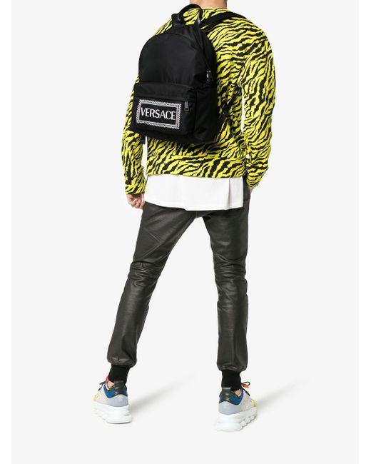 5252d5c9fa ... Versace - Black Logo Printed Nylon Backpack for Men - Lyst ...