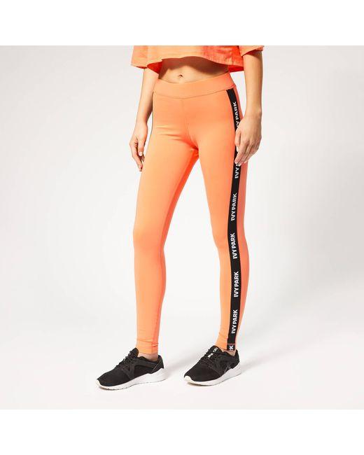 Ivy Park Orange V Active Logo Elastic Tape Tights
