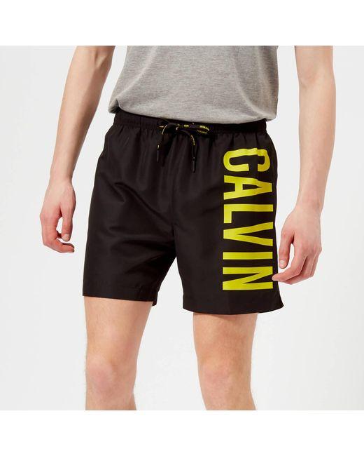 7ba846741a Calvin Klein - Black Logo Swim Shorts for Men - Lyst ...