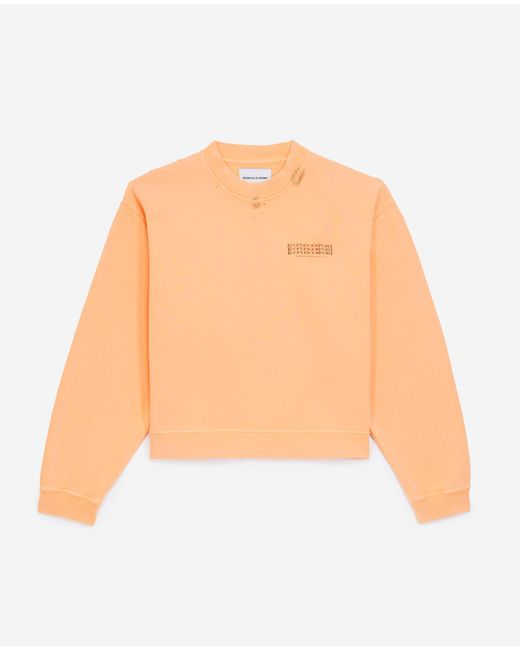 The Kooples Verwaschen orangenes Sweatshirtpiercingdetail