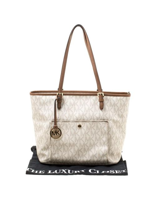 9488dffd0 ... MICHAEL Michael Kors - White Signature Coated Canvas Jet Set Pocket Tote  - Lyst ...