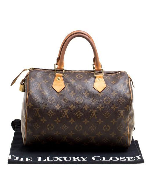 0b31c64ba90c ... Louis Vuitton - Brown Monogram Canvas And Leather Speedy 30 Bag - Lyst  ...