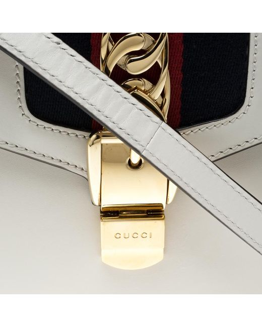 8c825404601 Lyst - Gucci Off White Leather Mini Sylvie Top Handle Bag in White ...