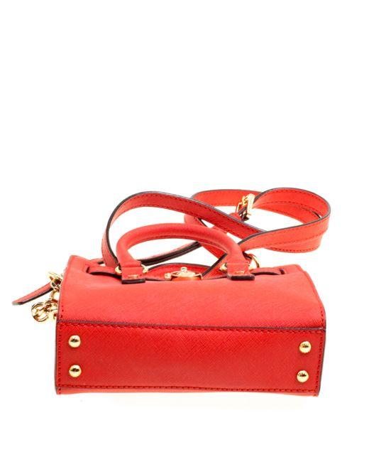 8a9601fa1b55 ... MICHAEL Michael Kors - Red Saffiano Leather Mini Hamilton Crossbody Bag  - Lyst ...