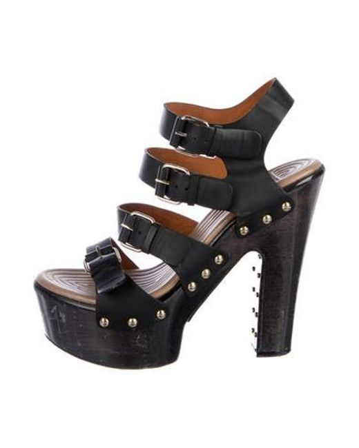 7f0549d6f6c Givenchy - Metallic Buckle-embellished Cage Sandals Black - Lyst ...