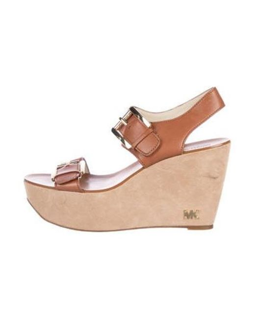 5b64dec08119 Michael Kors - Natural Buckle-accented Leather Wedges Tan - Lyst ...