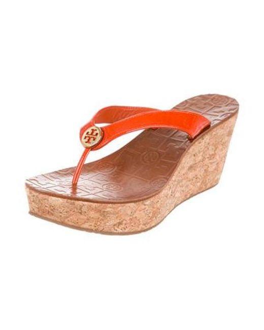 a23f37ec1ee13 ... Tory Burch - Metallic Patent Leather Logo Wedges Orange - Lyst ...