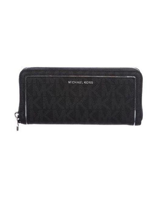 57634fdb02ad5b MICHAEL Michael Kors - Metallic Michael Kors Monogrammed Continental Wallet  Black - Lyst ...