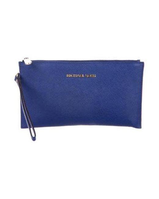 4529fed1b006 MICHAEL Michael Kors - Metallic Michael Kors Leather Zip Wristlet Blue -  Lyst ...