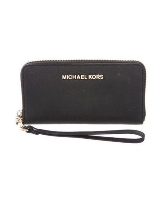 5227cc9f172d3 MICHAEL Michael Kors - Metallic Michael Kors Jet Set Travel Continental  Wallet Black - Lyst ...