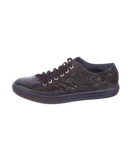 Chanel - Black Quilted Cc Sneakers - Lyst