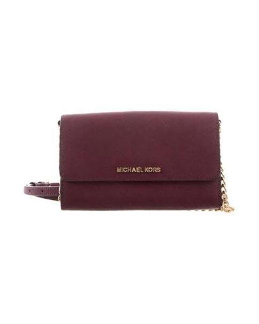 4aa5451cddc5 MICHAEL Michael Kors - Metallic Michael Kors Saffiano Leather Crossbody Bag  Violet - Lyst ...
