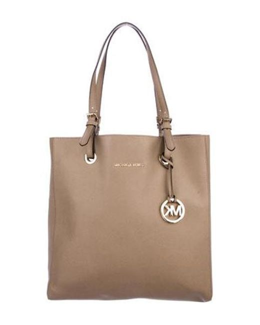 4932df0a83f91e MICHAEL Michael Kors - Metallic Michael Kors Textured Leather Tote Gold -  Lyst ...