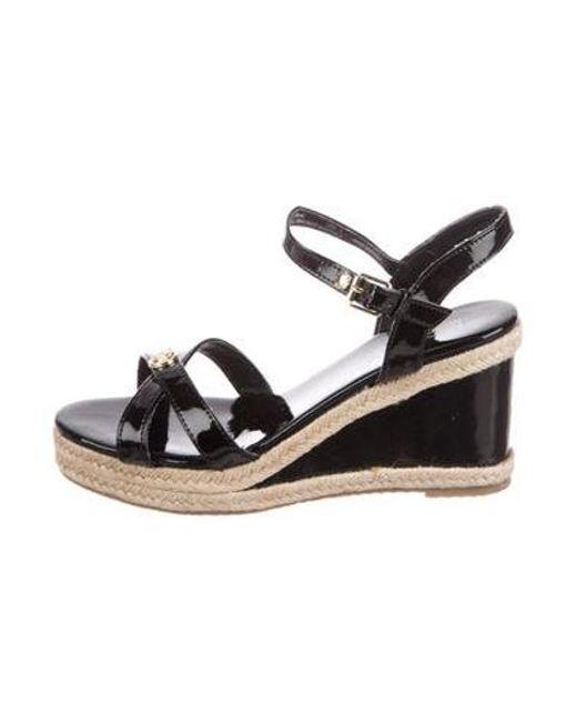 ea8cc3daaac MICHAEL Michael Kors - Metallic Michael Kors Crossover Wedge Sandals Black  - Lyst ...