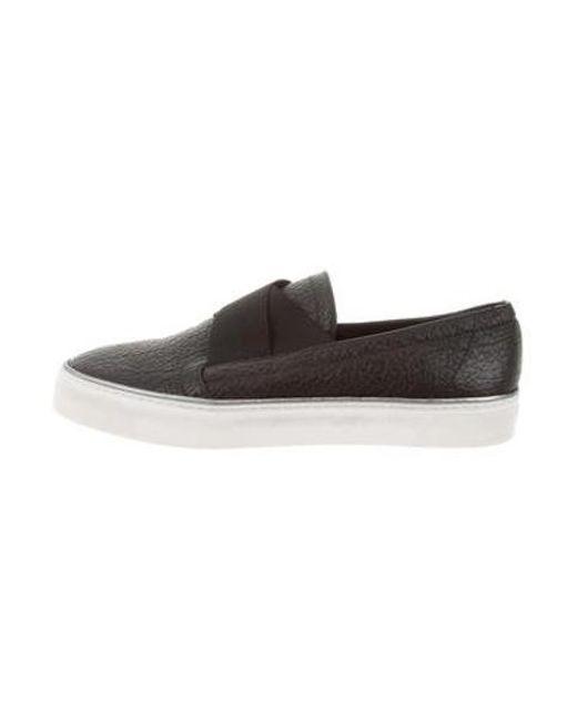 43e4b33b5ce6 Stuart Weitzman - Black Leather Slip-on Sneakers - Lyst ...
