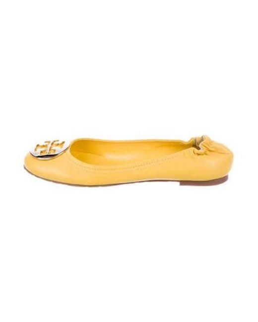 b6ea632393f6 Tory Burch - Metallic Reva Leather Flats Yellow - Lyst ...