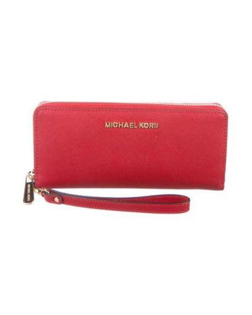 e5f8149c7e04 Michael Kors - Metallic Leather Wristlet Wallet Gold - Lyst ...