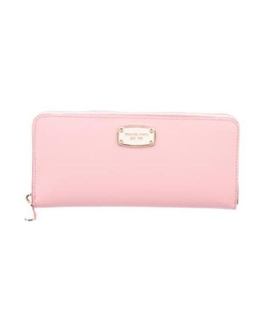 93f73652c029f MICHAEL Michael Kors - Metallic Michael Kors Jet Set Travel Wallet Pink -  Lyst ...