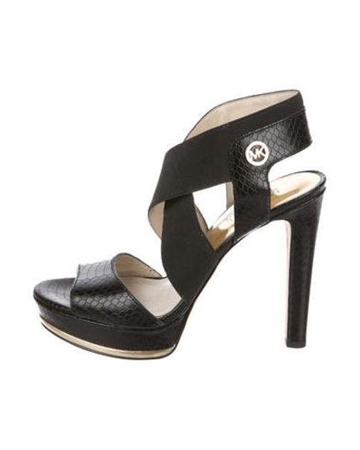2fbb97ef4f0 MICHAEL Michael Kors - Metallic Michael Kors Embossed Platform Sandals Black  - Lyst ...