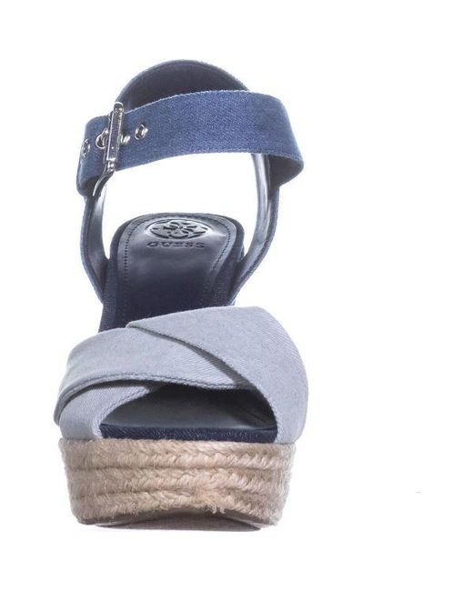 2bf498f8bfbb Lyst - Guess Sanda Ankle Strap Wedge Sandals in Blue - Save ...